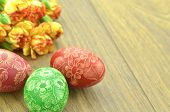 scratched handmade Easter egg and carnation flowers