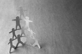 foto of human pyramid  - Human team pyramid on grey background - JPG