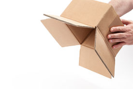 image of inverted  - Man is inverting an empty carton box - JPG