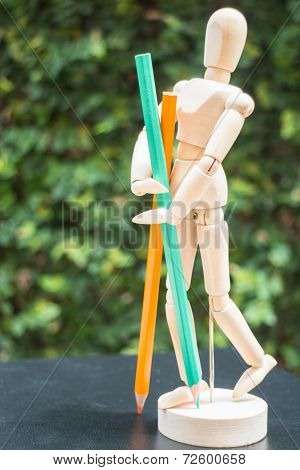 Wooden Artist Manikin Standing With Colour Pencil