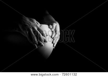 Father And Mother Bonding With An Unborn Baby
