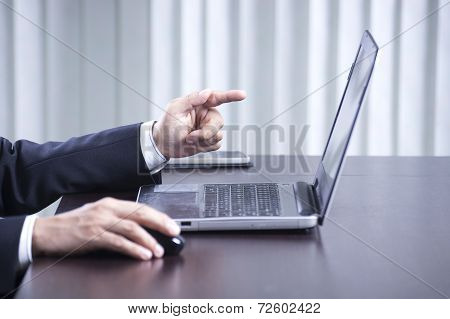 Business Man's Hands Using The Labtop Computer
