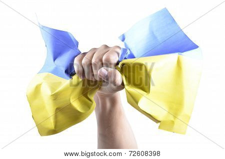 Hand Grasps The Ukrainian Flag