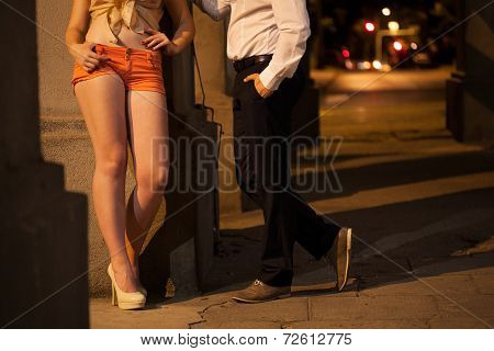 Man Talking With Prostitute