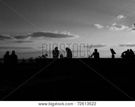 Human silhouettes in the evening