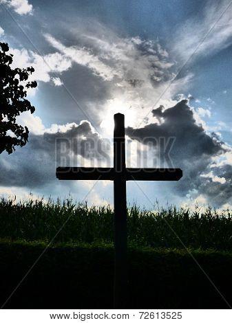 Crucifix under a stormy sky