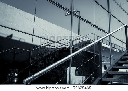 Detail Of A Glass Facade With Reflection And Handrail