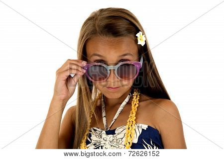 Adorable Girl In Island Style Dress Peering Over Her Sun Glasses