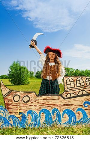 Girl in costume of pirate with black hat and sword