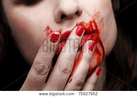 Female Vampire Licking Blood Off