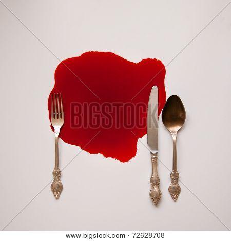 Tableware in a blood pool