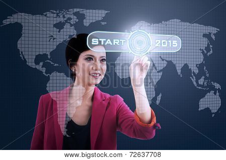 Woman Pressing Business Start Button