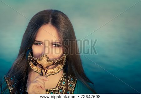 Young Woman Wearing Oriental Dress Holding Mask
