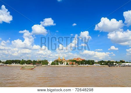 Grand palace and Longtail tourist boat in Chao Phraya river