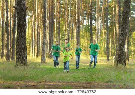 Happy cheerful family running