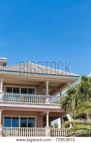 Pink Stucco Veranda With White Baustrade