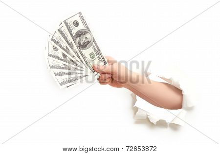 Human Hand With Money American Dollars Through  Hole In  White Paper
