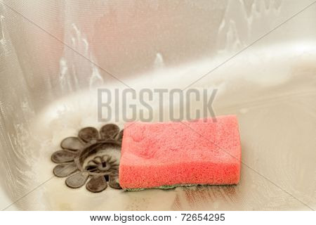 Washing Dishes. Kitchen Sink With Foam Sponge.