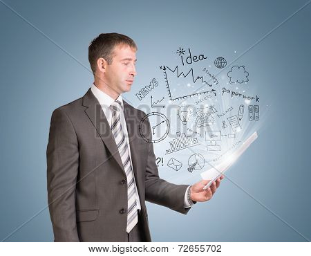 Businessman in suit hold paper sheets with business sketches