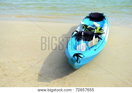 Blue Kayaks On The Tropical Beach