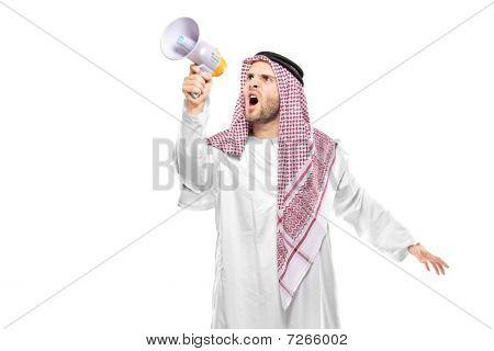 An irritated arab person screaming on a megaphone