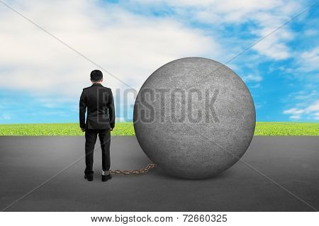 Business Man Being Trapped With Concrete Ball