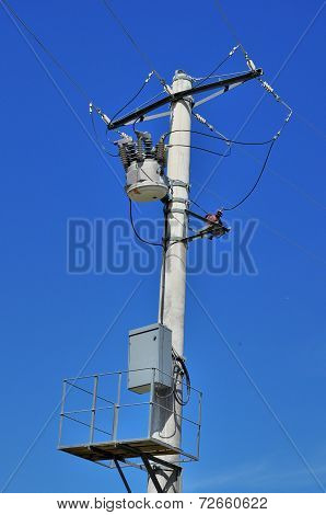 Distribution transformer on concrete power pole