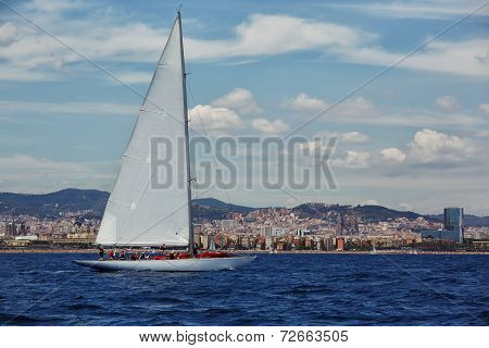 Racing on sailboat at sunny day, yacht racing, extreme sailing