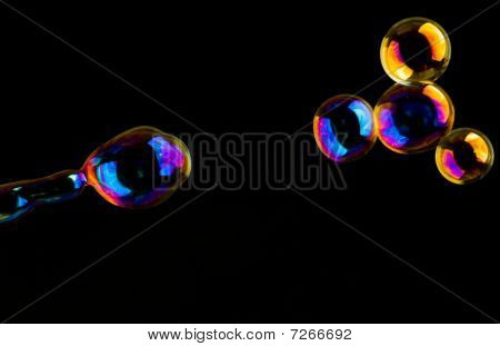 Extremely Colored Soap-bubbles In Red, Blue, Yellow And Magenta