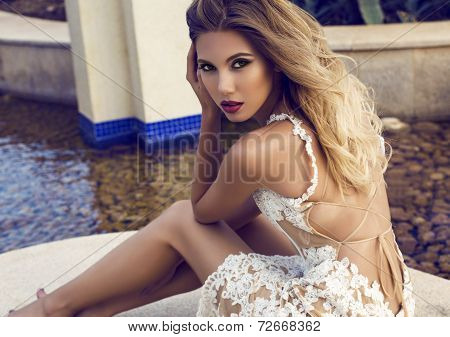 Beautiful Woman With Blond Hair In Elegant Lace Dress