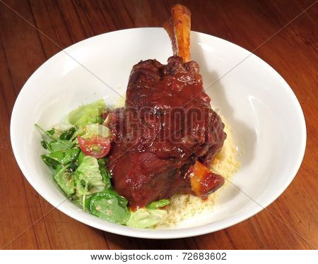 Lamb Shank With Couscous And Salad