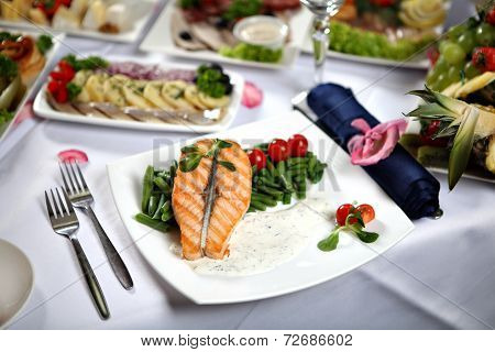 Grilled Salmon Steak With Green Beans, On Decorated Dining Table.