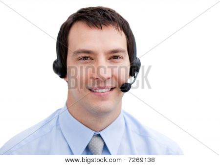 Portrait Of A Smiling Businessman With Headset On