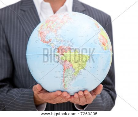 Close-up Of A Male Executive Holding A Terrestrial Globe