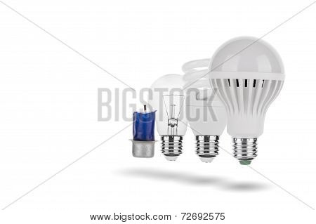 Evolution of light concept, candle, tungsten, fluorescent and LED bulb