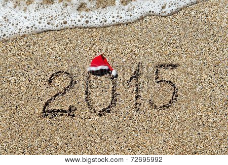 Happy New Year 2015 With Christmas Hat On Sandy Beach - Holiday