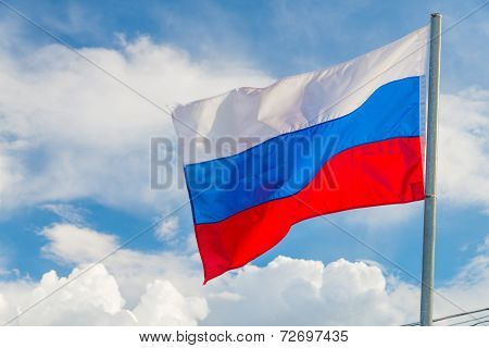 Russian Flag Waving In The Wind Over Sky