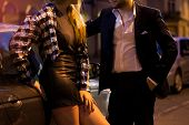 foto of prostitute  - Lonely businessman needs prostitute on the street - JPG