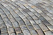 foto of pavestone  - Gray uneven paving stones illuminated by the sun - JPG