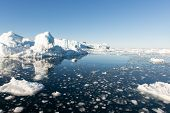 stock photo of gases  - Arctic seascape in Greenland around Disko Island with icebergs and blue sky - JPG