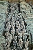 stock photo of qin dynasty  - Terracotta warriors in formation displayed in a burial pit at the Terracotta Army Museum in Xian China - JPG