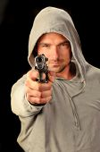 foto of gangsta  - A young white italian male holds a semi automatic pistol during this dark photo shoot against black - JPG
