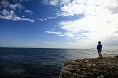 image of fishing rod  - Patient Fisherman with the Rod - JPG