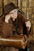 foto of bandit  - Mature female Bandit with gun in the wild west - JPG
