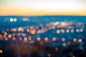 image of horizon  - city blurring lights abstract circular bokeh on blue background with horizon closeup - JPG