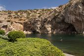 stock photo of thermal  - Vouliagmeni Thermal Radonic Mineral Water Lake near Athen Greece. Just outside of Athens lies the geophysical rarity known as Lake Vouliagmeni.