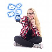 stock photo of sms  - young happy blondie woman sitting and sending sms from mobile phone isolated on white background - JPG