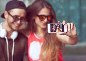 stock photo of selfie  - Young fashion couple taking selfie in the city - JPG