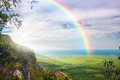 stock photo of cloudy  - beautiful landscape with cloudy blue sky and rainbow - JPG