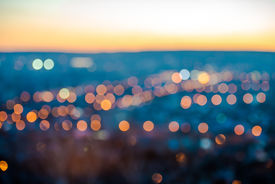 picture of flashing  - city blurring lights abstract circular bokeh on blue background with horizon closeup - JPG
